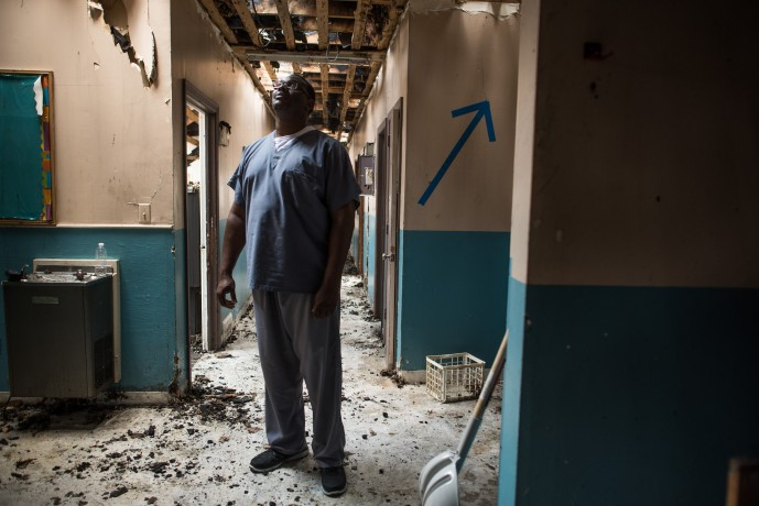 Mannix Kinsey, a copastor at the church, stands amidst the damage caused by a June fire.