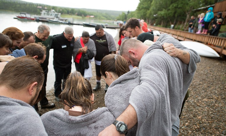 Baptized couples pray with our chaplains on the shores of Lake Clark.