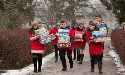 Local church youth deliver shoebox gifts to children in Moldova.