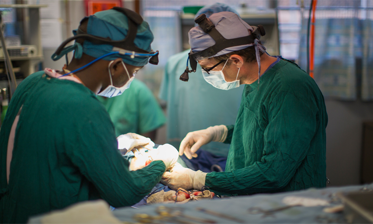 Dr. Warren Cooper spends his days performing surgeries that range from amputations to operating on machete wounds.