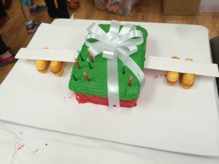 Brett's birthday cake in the shape of an Operation Christmas Child shoebox with wings