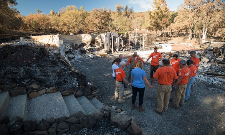Praying with homeowners in the wake of the Valley Fire.