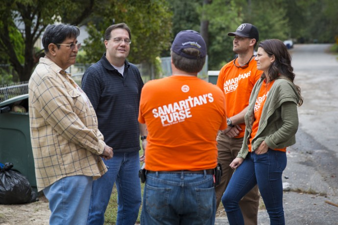 Corey and Cissie (at right), along with Samaritan's Purse staff member Ricky Critcher,  speak with Frank and Bobby (at left).