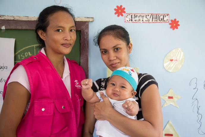 Rosemarie Natividad (left) leads a mother-to-mother support group in San Juan, Santa Fe, Philippines. Lerio Jacinto has learned how to better care for her son, Bradlee, who was born premature.