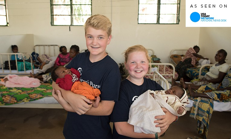 Siblings Gabe and Livvy Feinn with newborns at Nyankunde.