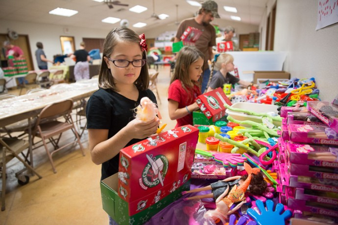 Young and old participated in the Operation Christmas Child shoebox packing party at Grace Baptist Church in Wild Peach, Texas.