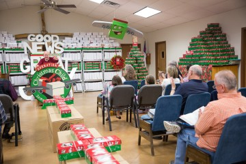 Congregants at Grace Baptist Church celebrate all that God has done and will do. The church rejoiced to fill 2,118 shoeboxes this year.