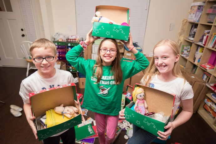 Jordyn, DJ (left), and Averi (right) helped make bracelets to stuff into shoeboxes.