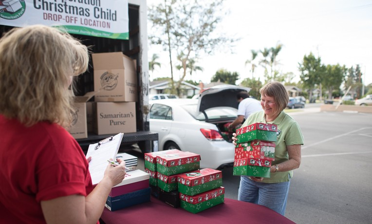Carole Cole (center) is a logistics volunteer in California for Operation Christmas Child.