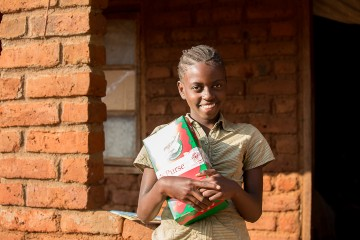 Angella with an Operation Christmas Child shoebox gift.