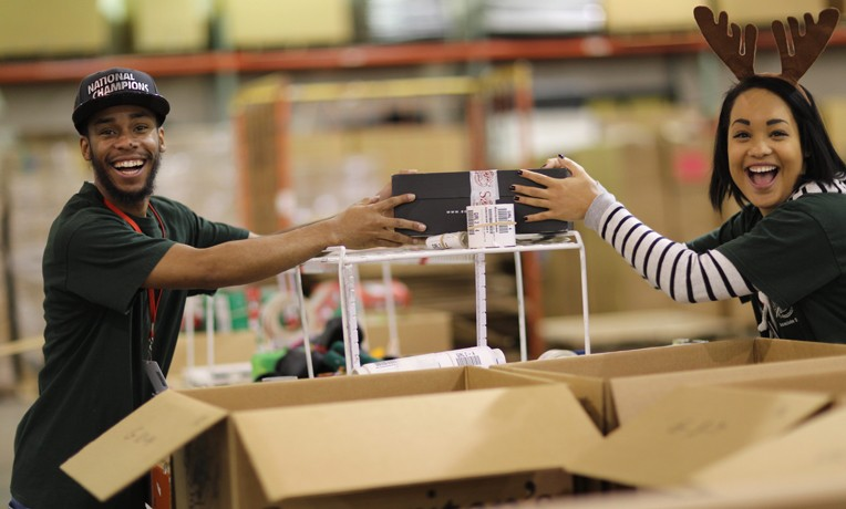 Volunteers work hard and have fun while processing thousands of shoeboxes.