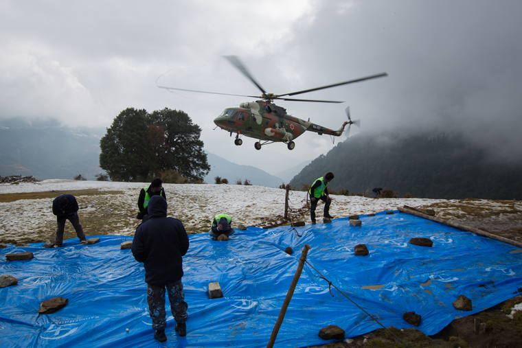Helicopters are transporting relief to remote areas of Nepal.