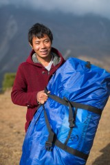 "Kari Ghale, 24, received winter relief items from Samaritan's Purse. He said it was ""a beautiful sight"" to see goods airlifted to his remote region."