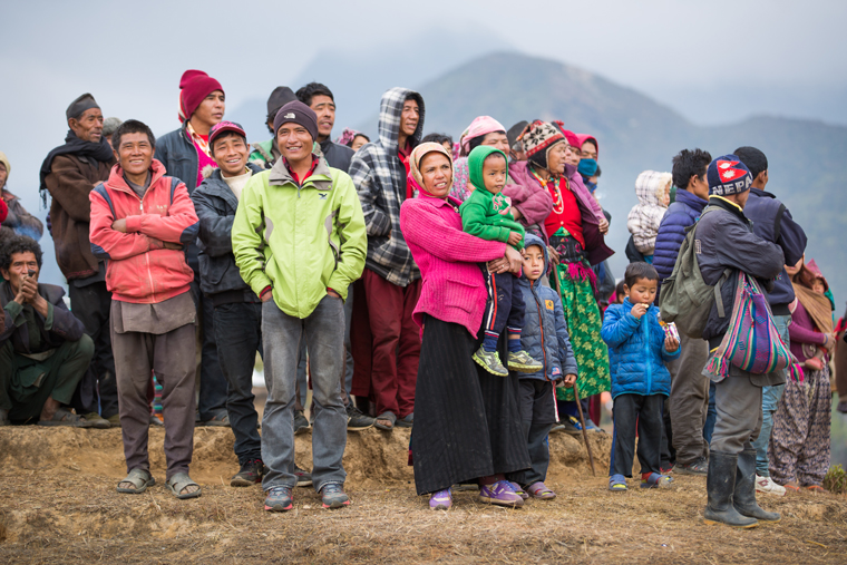 Villagers wait as relief from Samaritan's Purse arrives by military helicopter.