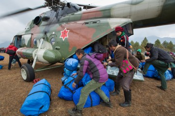 Unloading relief in Nepal from helicopter