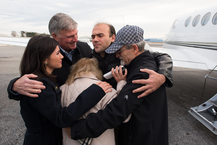 Franklin Graham embraces Pastor Saeed, along with his parents and sister.