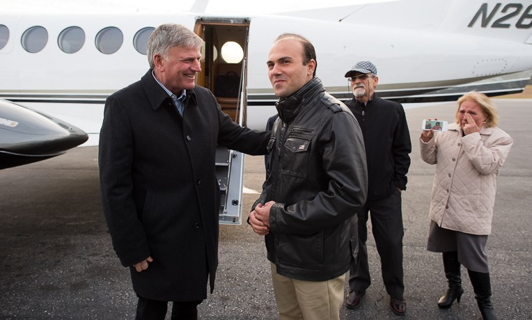 Franklin Graham greets Pastor Saeed Abedini. Saeed's parents stand behind them.