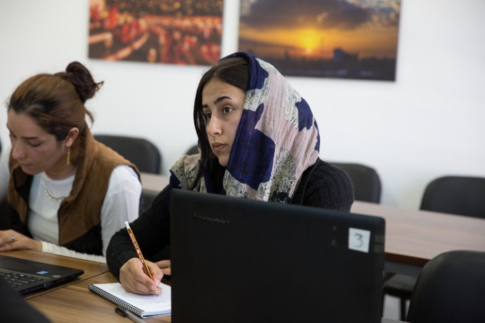 Women displaced by ISIS terror learn to use the computer at Grace Community Center, a work of Samaritan's Purse in northern Iraq.