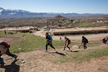 Children run up a hill in Northern Iraq. The location is home to a Samaritan's Purse Child-Friendly Learning Space where they take classes.
