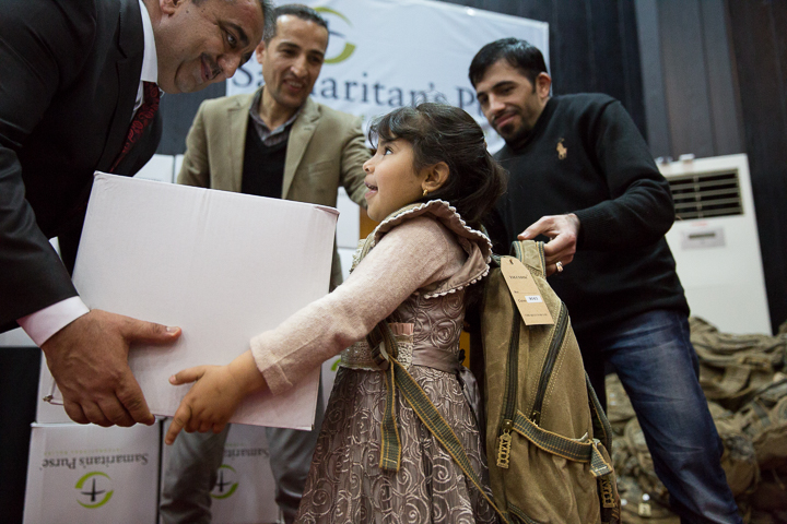 Children receive winter clothes and OCC shoeboxes in Iraq.