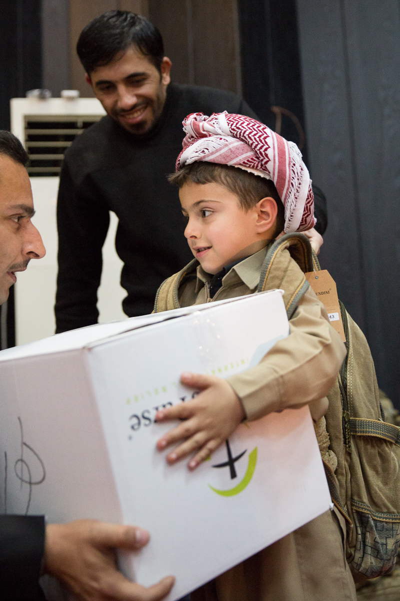 Children of Peshmerga soldiers receive winter clothes and an Operation Christmas Child shoebox from Samaritan's Purse.
