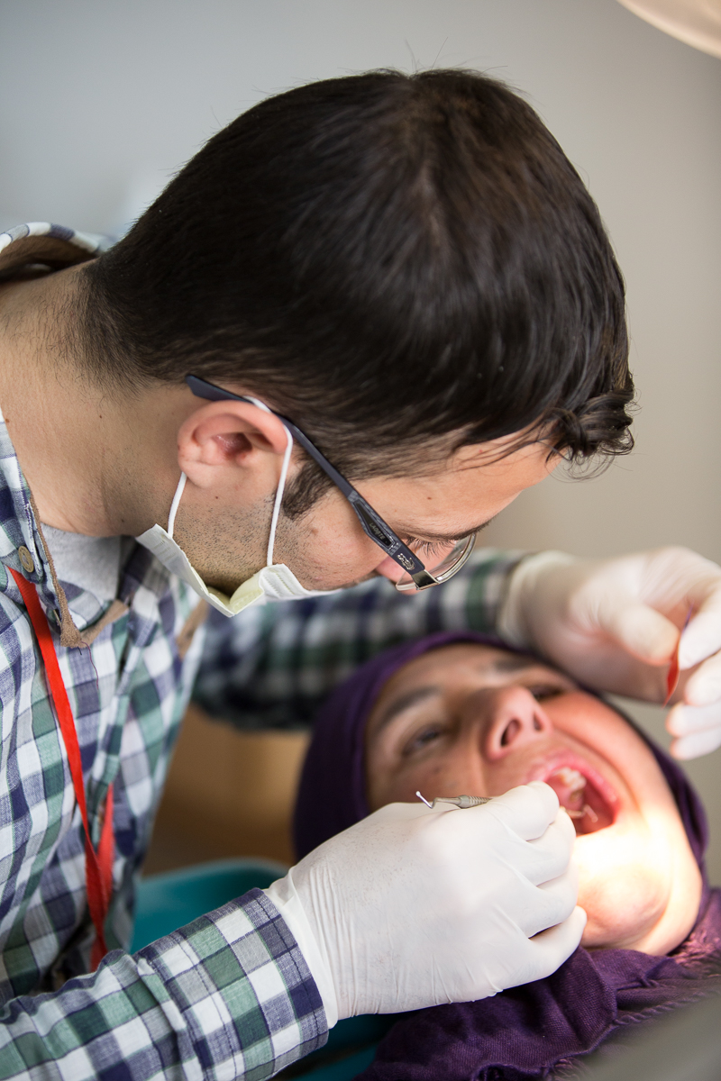 Dentist working on patient at Fountain of Love in northern Iraq. Samaritan's Purse.
