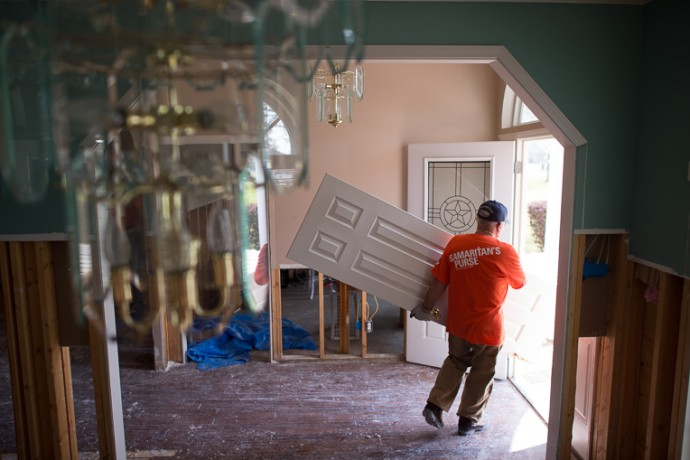 A Samaritan's Purse volunteer removes items from a flooded home in north Louisiana.