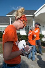 Kayla Muth, Samaritan's Purse volunteer, signs a Bible for a homeowner in Louisiana. helping after flooding in Monroe