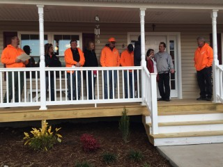 The dedication of the Johnsons' new home.