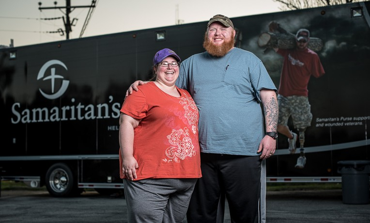Brandon and Ashley Price in front of a Samaritan's Purse disaster relief unit.