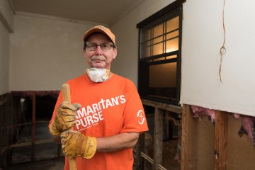 Volunteer Jeff Colvin, a retired police officer from Conroe, Texas, helped out in Orange County.