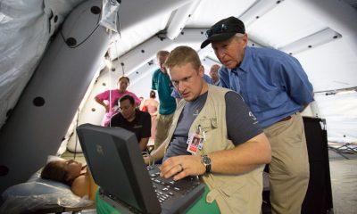 Samaritan's Purse relief; Dr. Richard Furman (background) observes as Dr. Elliott Tenpenny conducts an ultrasound at our emergency field hospital in Ecuador.