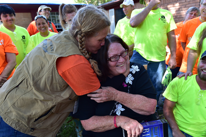 Samaritan's Purse Site Team Leader Leslie Meinen hugs her mother Donna Thompson. We worked on Donna's home this weekend and presented her a new Bible.