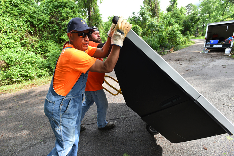 Fernando Salas traveled by train, plane, and automobile (literally) to flooded parts of Houston where he helped remove walls, flooring, and debris from waterlogged homes. Samaritan's Purse mudout volunteers save days of work for already-weary homeowners.