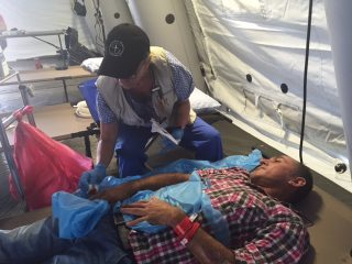 Ecuador earthquake, Samaritan's Purse, Alex Saltos being treated by our medical staff in Chone