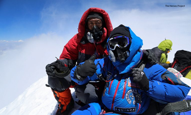 Charlie Linville (blue) was the first combat-wounded veteran to scale Mount Everest, the world's highest mountain.