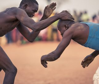 Refugees in South Sudan receive relief from Samaritan's Purse. Nuba Mountains. Wrestling. Yida.