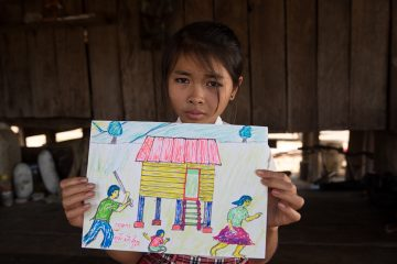 Yan Lot and Phan Eap's daughter drew this photo to describe her family before Samaritan's Purse helped her parents.