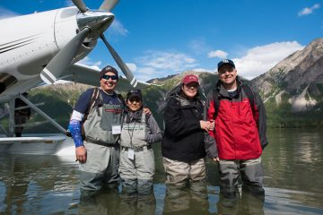 Wounded veterans enjoy fishing during a marriage retreat in Alaska
