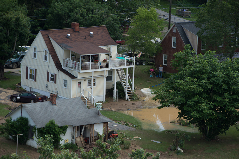 Families across West Virginia have suffered extensive damage to their homes during recent flooding. Aerial photo taken June 25.