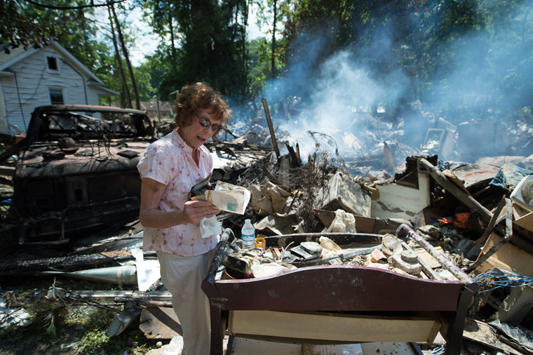 Homeowners are starting the difficult work of recovery in West Virginia.
