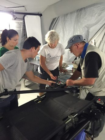 Jim Moore (right), Samaritan's Purse technical support supervisor, goes over the functionality of the equipment in the emergency field hospital. He helped with the transfer of the mobile unit to Ecuador's Ministry of Health.