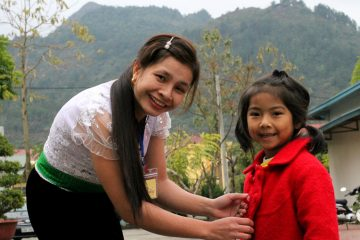 Lo Thi Chieng works hard caring for her kindergarten students.
