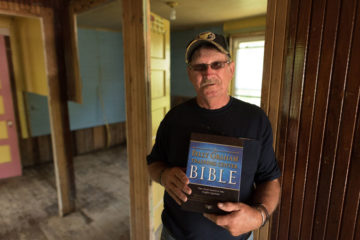Leroy Foster received a Bible signed by all the U.S. Disaster Relief volunteers who helped clean up his home. He also received Christ as Savior.