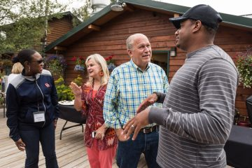 Governor Bill Walker and his wife Donna speak with Army Staff Sergeant Michael Matthews and his wife Army Sergeant Krystle Matthews.