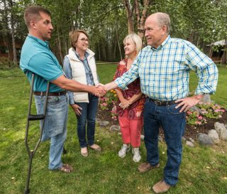 Governor Bill Walker and his wife Donna met Army Lieutenant Colonel Daniel Gade and his wife Wendy.