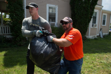 Saints players teamed with Samaritan's Purse volunteers to work in West Virginia.