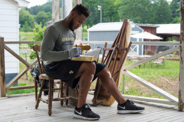 Vonn Bell signs a Bible for homeowner Barbara Long in West Virginia.
