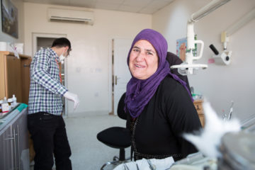 Iraqi woman smiling after dental care