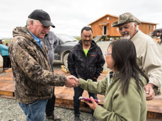 Franklin Graham meets with members of Togiak Moravian Church in the remote village of Togiak, Alaska, where Samaritan's Purse volunteers have spent the summer building a new building and parsonage for the congregation.